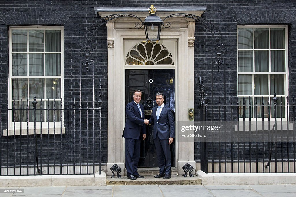 British Prime Minister, <a gi-track='captionPersonalityLinkClicked' href=/galleries/search?phrase=David+Cameron+-+Politician&family=editorial&specificpeople=227076 ng-click='$event.stopPropagation()'>David Cameron</a>, greets NATO Secretary General, <a gi-track='captionPersonalityLinkClicked' href=/galleries/search?phrase=Anders+Fogh+Rasmussen&family=editorial&specificpeople=549374 ng-click='$event.stopPropagation()'>Anders Fogh Rasmussen</a>, at 10 Downing Street on June 19, 2014 in London, England. During his visit to the United Kingdom the Secretary General will meet the Prime Minister, <a gi-track='captionPersonalityLinkClicked' href=/galleries/search?phrase=David+Cameron+-+Politician&family=editorial&specificpeople=227076 ng-click='$event.stopPropagation()'>David Cameron</a>, the Foreign Secretary, William Hague MP, and the Defence Secretary, Philip Hammond MP.
