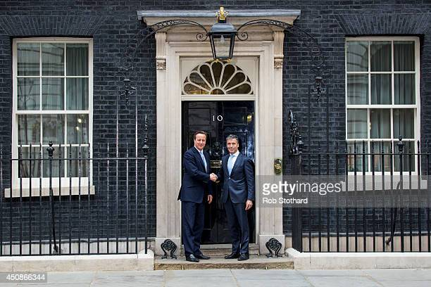 British Prime Minister David Cameron greets NATO Secretary General Anders Fogh Rasmussen at 10 Downing Street on June 19 2014 in London England...