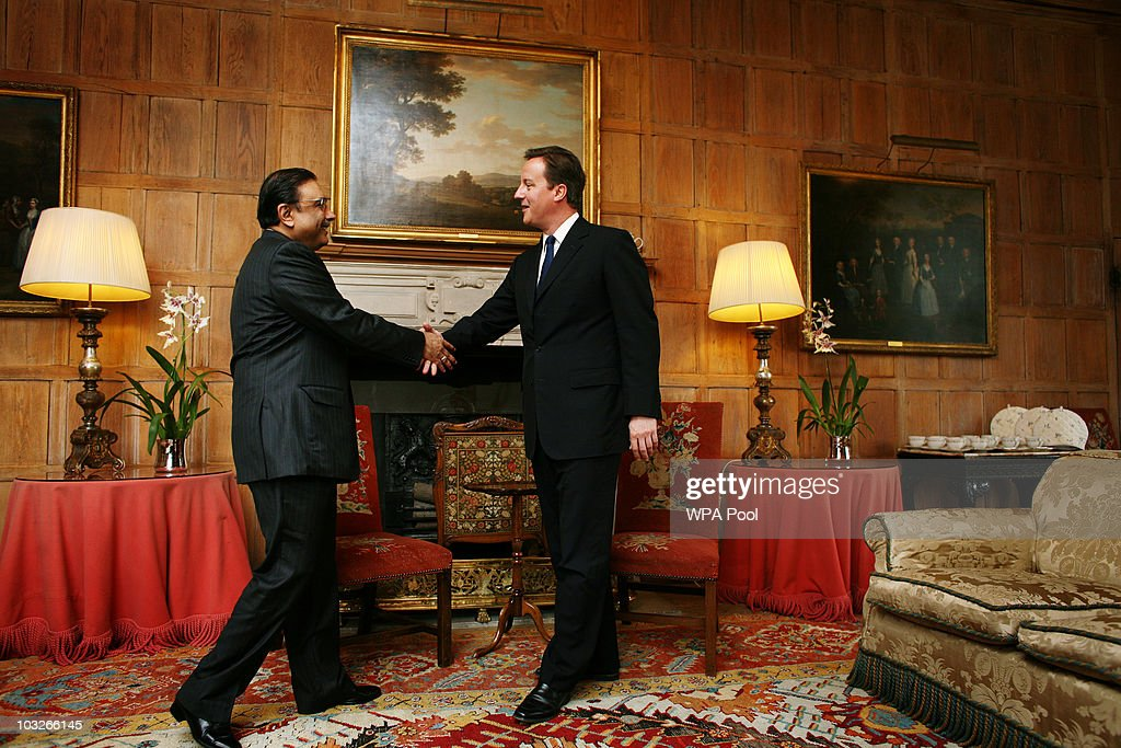 British Prime Minister <a gi-track='captionPersonalityLinkClicked' href=/galleries/search?phrase=David+Cameron+-+Politician&family=editorial&specificpeople=227076 ng-click='$event.stopPropagation()'>David Cameron</a> (R) greets Pakistan's President <a gi-track='captionPersonalityLinkClicked' href=/galleries/search?phrase=Asif+Ali+Zardari&family=editorial&specificpeople=1125723 ng-click='$event.stopPropagation()'>Asif Ali Zardari</a> on August 6, 2010 at Chequers near Princes Risborough, England. President Zardari has been criticised at home for his diplomatic visit to the UK as the worst flooding in Pakistan's history has killed over 1600 people and affected four million.