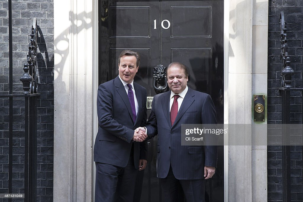 British Prime Minister David Cameron (L) greets Prime Minister of Pakistan Muhammad <a gi-track='captionPersonalityLinkClicked' href=/galleries/search?phrase=Nawaz+Sharif&family=editorial&specificpeople=217726 ng-click='$event.stopPropagation()'>Nawaz Sharif</a> in Downing Street on April 30, 2014 in London, England. During his visit to the UK, Mr Sharif is scheduled to meet with David Cameron, address an Investment Conference and meet members of the Pakistani Diaspora.