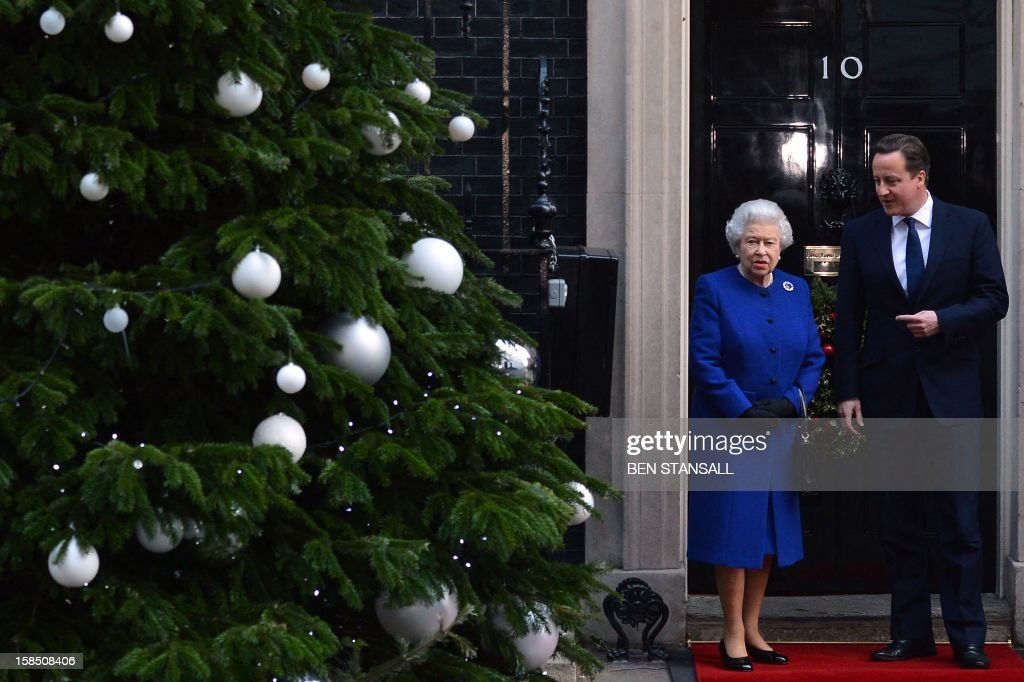 British Prime Minister David Cameron (R) greets Queen Elizabeth II (L) at the door of no 10 Downing Street in London December 18, 2012 as the monarch arrives to sit in as an observer during a meeting of the Cabinet. Queen Elizabeth II attended her first-ever cabinet meeting on Tuesday to mark her diamond jubilee, the only monarch to do so since 1781.The 86-year-old sovereign sat in as an observer on the meeting and received a gift from the Cabinet to celebrate her 60 years on the throne.