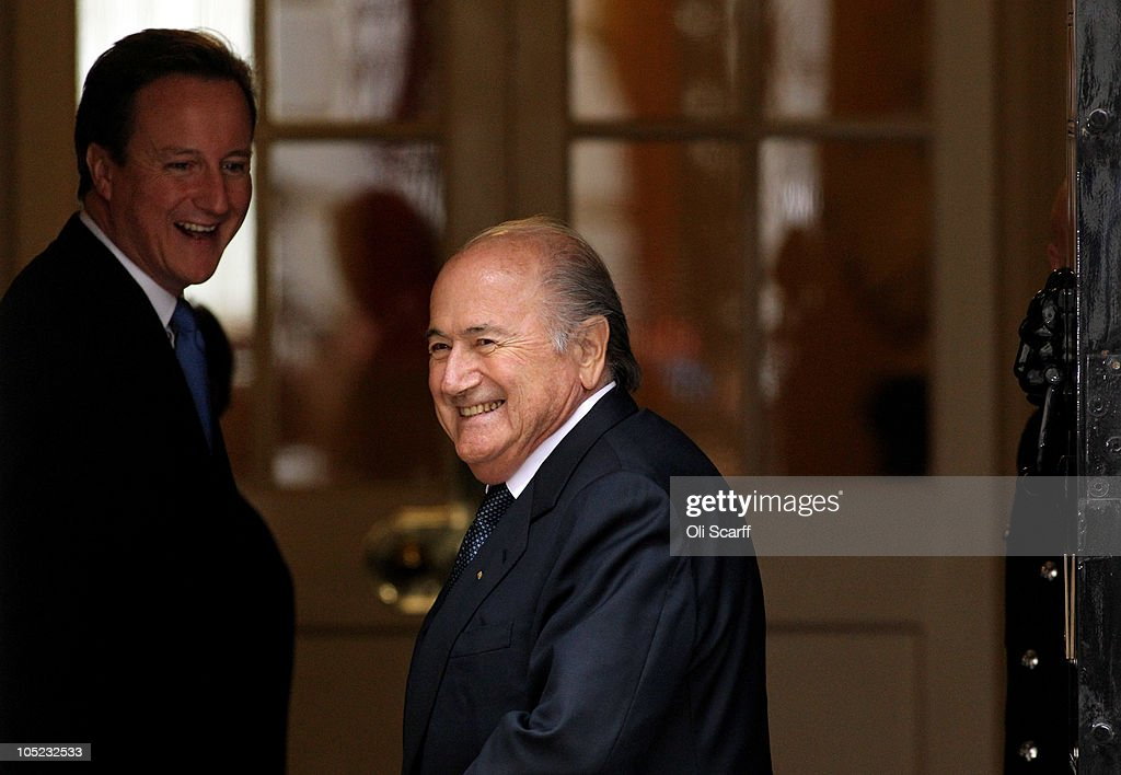 British Prime Minister David Cameron (L) greets Sepp Blatter, the President of FIFA, outside Number 10 Downing Street on October 13, 2010 in London, England. Mr Blatter arrived to discuss England's bid for the 2018 World Cup, he is due to watch a video presentation and meet with Government ministers and bid ambassadors.