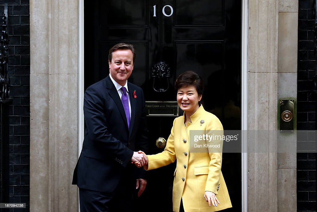 British Prime Minister <a gi-track='captionPersonalityLinkClicked' href=/galleries/search?phrase=David+Cameron+-+Politician&family=editorial&specificpeople=227076 ng-click='$event.stopPropagation()'>David Cameron</a> greets South Korea's President Park Geun-Hye outside 10 Downing Street in London, on November 6, 2013 in London, England. The President of the Republic of Korea Park Geun-Hye is on a State Visit to the United Kingdom.
