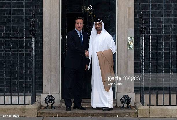 British Prime Minister David Cameron greets the Crown Prince of Abu Dhabi Mohammed bin Zayed Al Nahyan at 10 Downing Street on October 16 2014 in...