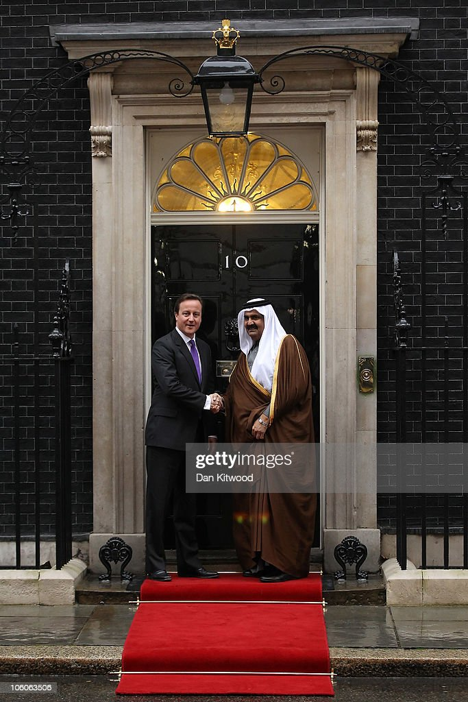 British Prime Minister <a gi-track='captionPersonalityLinkClicked' href=/galleries/search?phrase=David+Cameron+-+Politician&family=editorial&specificpeople=227076 ng-click='$event.stopPropagation()'>David Cameron</a> (L) greets the Emir of Qatar, Sheikh Hamad bin Khalifa al Thani at 10 Downing Street on October 26, 2010 in London, England. The Sheikh is on a two day State visit to the UK, the first since his last in 1985, which is seen as important in strengthening already strongly established business links with one of the Gulf States most financially powerful nations.