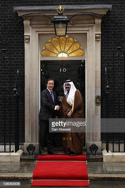 British Prime Minister David Cameron greets the Emir of Qatar Sheikh Hamad bin Khalifa al Thani at 10 Downing Street on October 26 2010 in London...