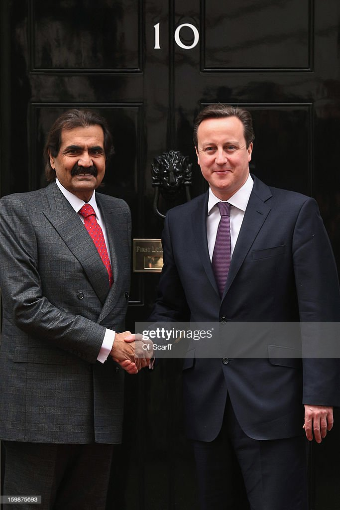 British Prime Minister <a gi-track='captionPersonalityLinkClicked' href=/galleries/search?phrase=David+Cameron+-+Politicus&family=editorial&specificpeople=227076 ng-click='$event.stopPropagation()'>David Cameron</a> greets the Emir of Qatar, Sheikh Hamad bin Khalifa Al Thani (L) at Number 10 Downing Street on January 22, 2013 in London, England. During his meeting with Prime Minister Cameron at Downing Street, the Emir of Qatar is expected to discuss the situations in Syria and Iran as well as the Emir's business interests in the UK. Mr Cameron is due to deliver a long-awaited speech on Britain's relationship with the EU tomorrow.