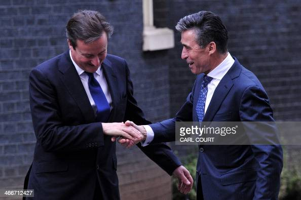 British Prime Minister David Cameron greets the NATO Secretary General Anders Fogh Rasmussen outside 10 Downing Street central London on February 3...