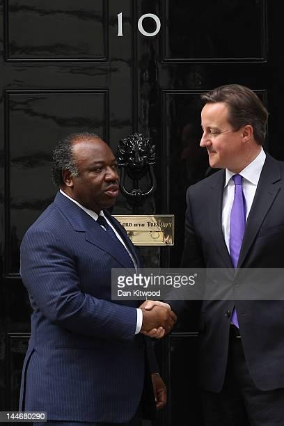 British Prime Minister David Cameron greets the President Of Gabon AliBen Bongo Ondimba at 10 Downing Street on May 17 2012 in London England Mr...
