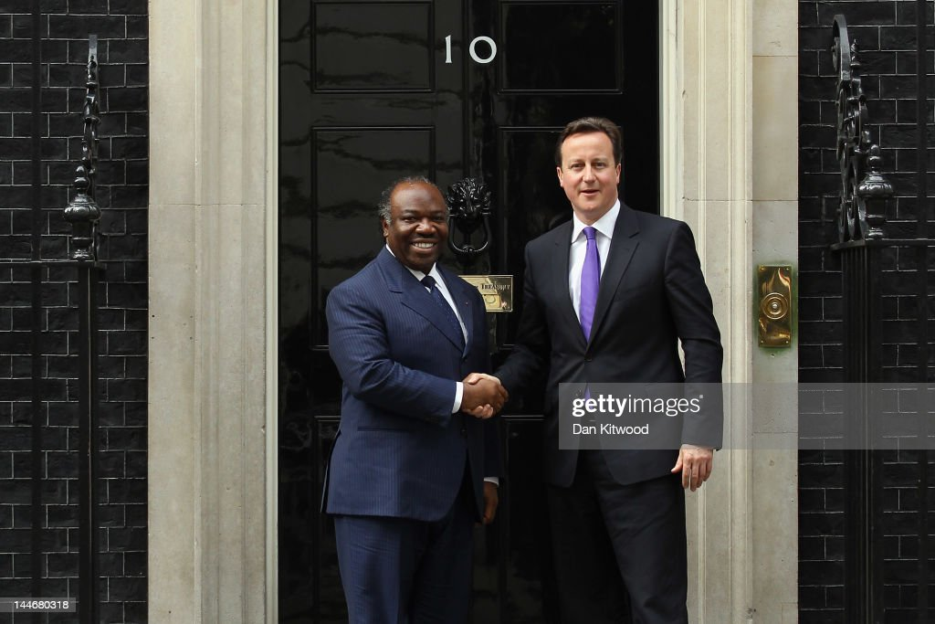 British Prime Minister <a gi-track='captionPersonalityLinkClicked' href=/galleries/search?phrase=David+Cameron+-+Politician&family=editorial&specificpeople=227076 ng-click='$event.stopPropagation()'>David Cameron</a> greets the President Of Gabon Ali-Ben Bongo Ondimba at 10 Downing Street on May 17, 2012 in London, England. Mr Ondimba is on a two day visit to the UK where he hopes to discuss trade relations with Mr Cameron.