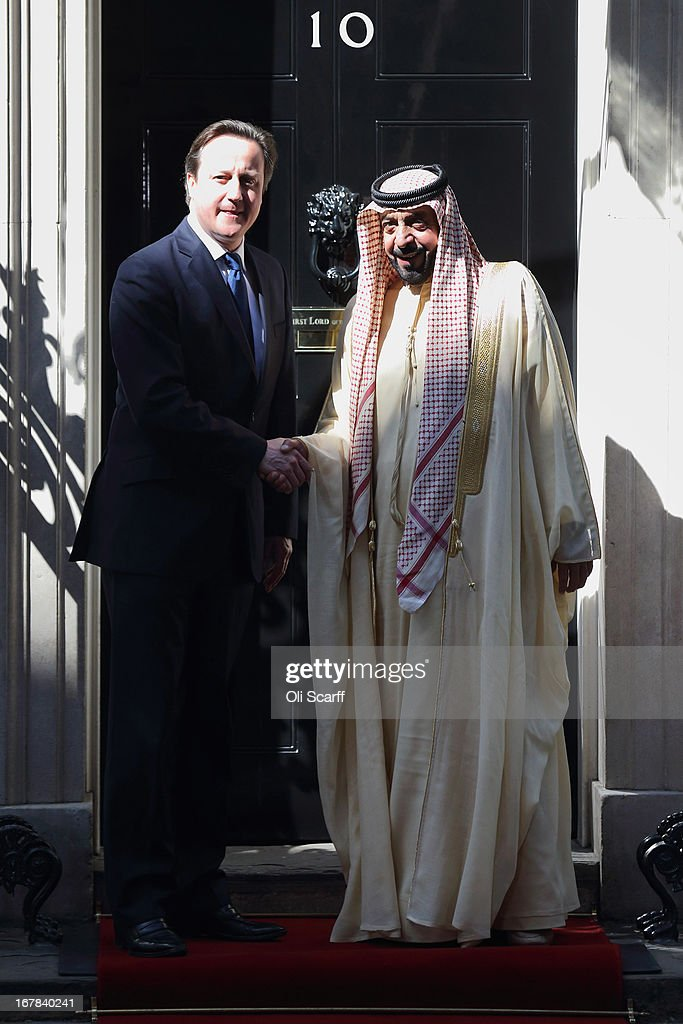 British Prime Minister <a gi-track='captionPersonalityLinkClicked' href=/galleries/search?phrase=David+Cameron+-+Politician&family=editorial&specificpeople=227076 ng-click='$event.stopPropagation()'>David Cameron</a> (L) greets the President of the United Arab Emirates, His Highness Sheikh Khalifa bin Zayed Al Nahyan, in Downing Street on May 1, 2013 in London, England. The President of the United Arab Emirates is paying a two-day State Visit to the United Kingdom, staying in Windsor Castle as the guest of Her Majesty The Queen from April 30, 2013 to May 1, 2013.