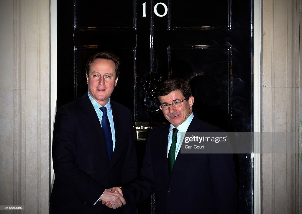 British Prime Minister <a gi-track='captionPersonalityLinkClicked' href=/galleries/search?phrase=David+Cameron+-+Politician&family=editorial&specificpeople=227076 ng-click='$event.stopPropagation()'>David Cameron</a> (L) greets Turkey's Prime Minister <a gi-track='captionPersonalityLinkClicked' href=/galleries/search?phrase=Ahmet+Davutoglu&family=editorial&specificpeople=4940018 ng-click='$event.stopPropagation()'>Ahmet Davutoglu</a> on January 20, 2015 in Downing Street in London, England. The Turkish leader is in London on a three day visit.