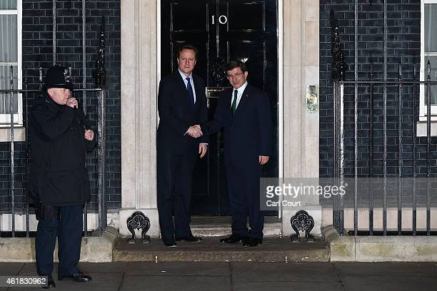 British Prime Minister David Cameron greets Turkey's Prime Minister Ahmet Davutoglu on January 20 2015 in Downing Street in London England The...