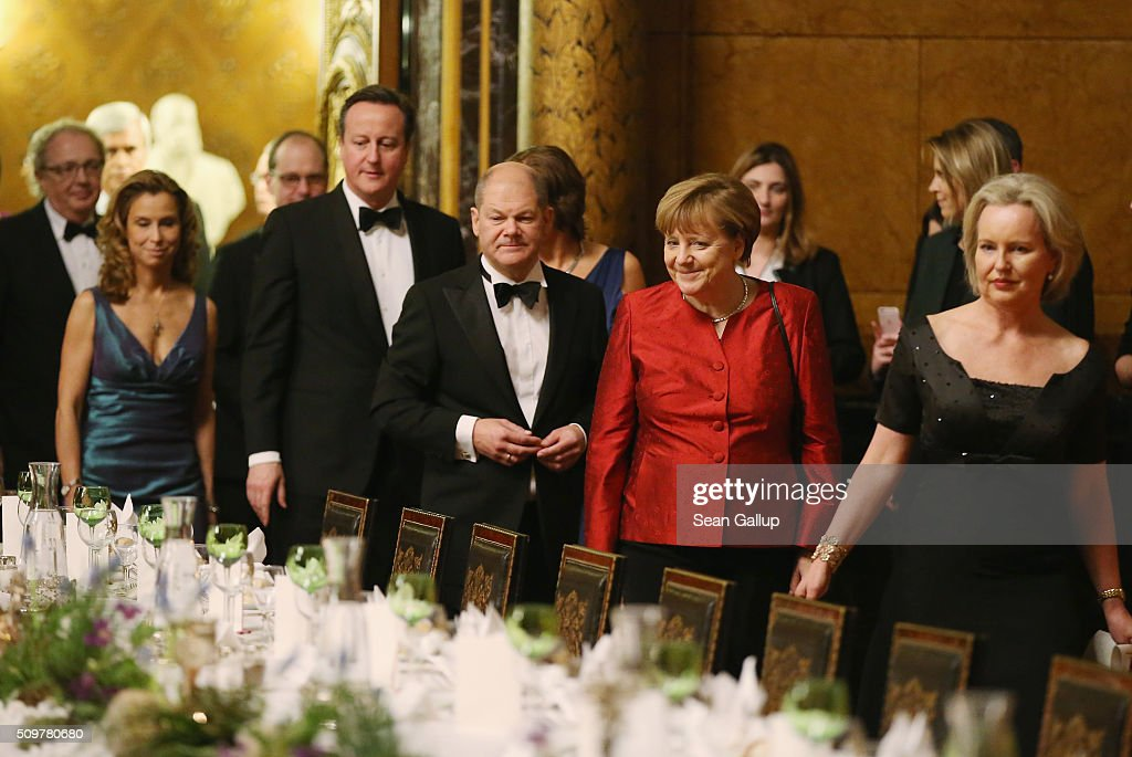 British Prime Minister <a gi-track='captionPersonalityLinkClicked' href=/galleries/search?phrase=David+Cameron+-+Politician&family=editorial&specificpeople=227076 ng-click='$event.stopPropagation()'>David Cameron</a> (C-L), Hamburg Mayor <a gi-track='captionPersonalityLinkClicked' href=/galleries/search?phrase=Olaf+Scholz&family=editorial&specificpeople=2162609 ng-click='$event.stopPropagation()'>Olaf Scholz</a>(C) and German Chancellor <a gi-track='captionPersonalityLinkClicked' href=/galleries/search?phrase=Angela+Merkel&family=editorial&specificpeople=202161 ng-click='$event.stopPropagation()'>Angela Merkel</a> (C-R) attend the annual Matthiae-Mahl dinner at Hamburg City Hall on February 12, 2016 in Hamburg, Germany. The two leaders are there on the invitation of Hamburg Mayor <a gi-track='captionPersonalityLinkClicked' href=/galleries/search?phrase=Olaf+Scholz&family=editorial&specificpeople=2162609 ng-click='$event.stopPropagation()'>Olaf Scholz</a>, who reportedly saw the dinner as a gesture to show Germany's hope that Great Britain will remain in the European Union. The Matthiae-Mahl is a Hamburg tradition dating back to 1356 and began as a fest to welcome the spring season and also to honor a foreign official.