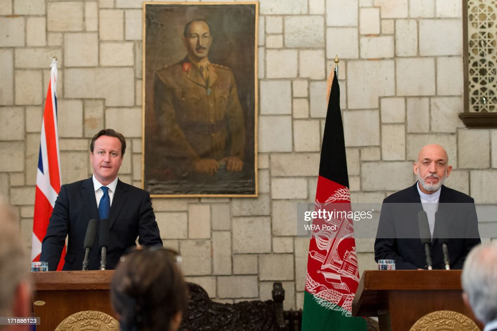 British Prime Minister David Cameron holds a press conference with President of Afghanistan Hamid Karzai in the Presidential Palace on June 29 2013...