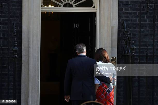 British Prime Minister David Cameron holds with his wife Samantha Cameron walking back after resigning on the steps of 10 Downing Street on June 24...