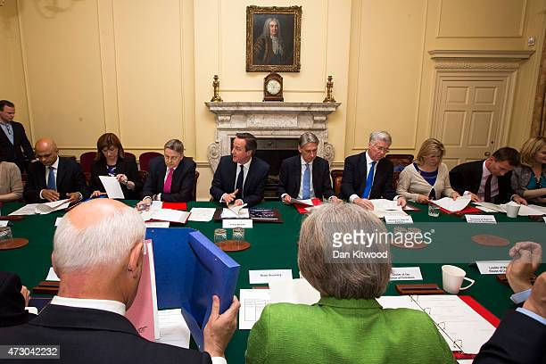 British Prime Minister David Cameron hosts the first cabinet meeting with his new cabinet in Downing Street on May 12 2015 in London England...