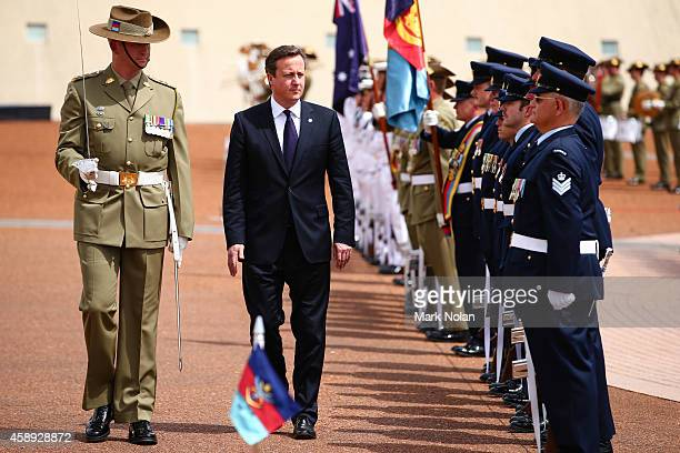 British Prime Minister David Cameron inspects the guard at Parliament House on November 14 2014 in Canberra Australia British Prime Minister David...