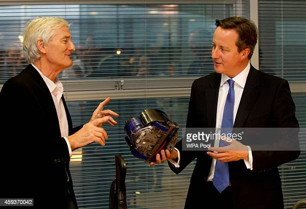 British Prime Minister David Cameron is given a tour of the Dyson factory by Sir James Dyson on November 21 204 in Malmesbury England