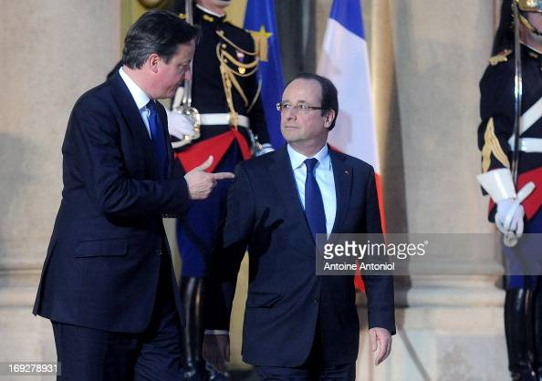 British Prime Minister David Cameron is greeted by French President Francois Hollande ahead of a press conference at Elysee Palace on May 22 2013 in...