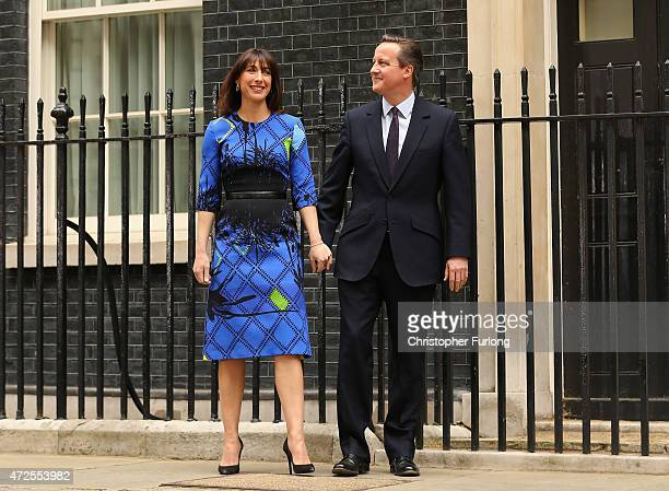 British Prime Minister David Cameron is joined by his wife Samantha Cameron after delivering a speech outside 10 Downing Street on May 8 2015 in...