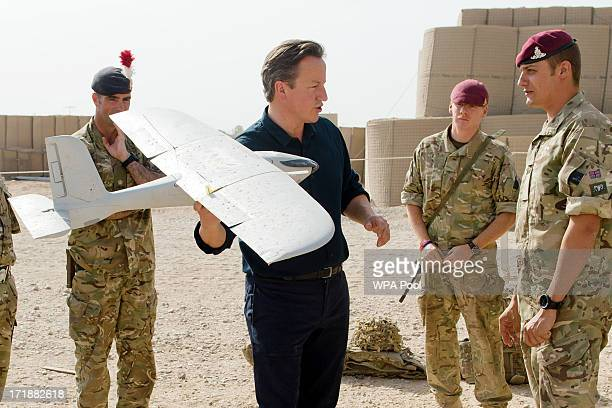 British Prime Minister David Cameron is shown a remotecontrolled IED detection unit used in regional operations during a visit to Camp Bastion on...