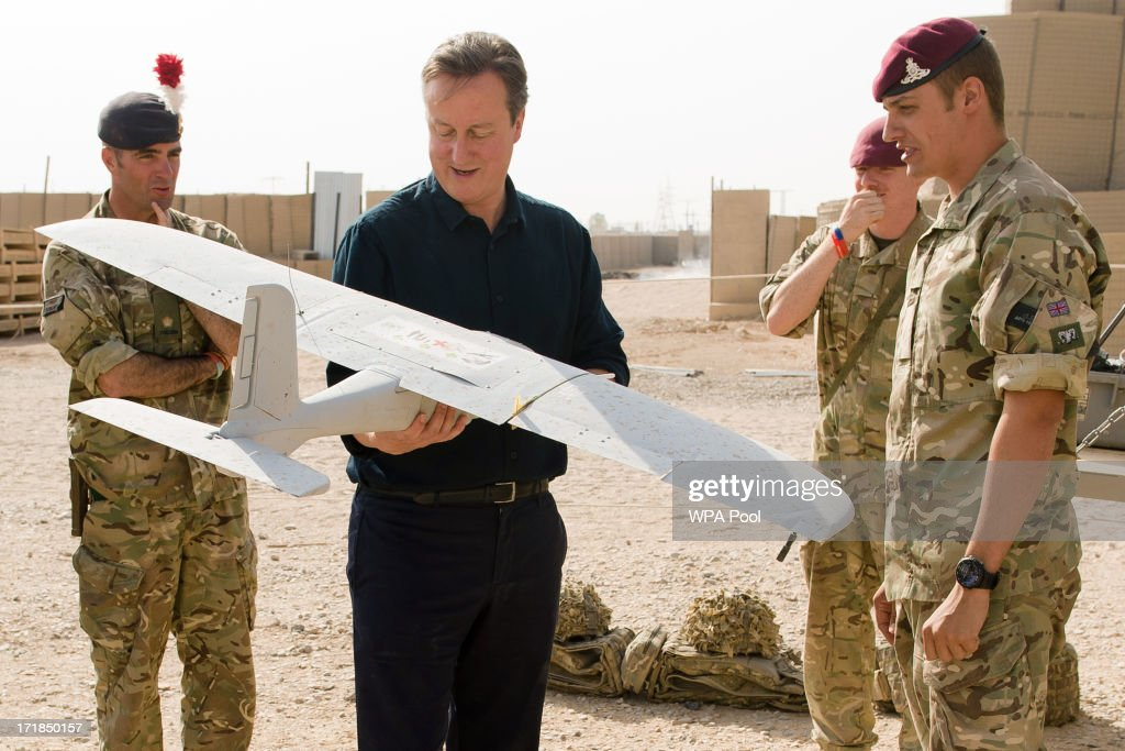 British Prime Minister <a gi-track='captionPersonalityLinkClicked' href=/galleries/search?phrase=David+Cameron+-+Politico&family=editorial&specificpeople=227076 ng-click='$event.stopPropagation()'>David Cameron</a> is shown a remote-controlled surveillance aircraft used in regional operations during a visit to Camp Bastion on June 29, 2013 near Lashkar Gah, in the southern Helmand province, Afghanistan. Cameron made an unannounced visit to Afghanistan visiting troops in Helmand as the NATO military coalition hands responsibility over to local forces.