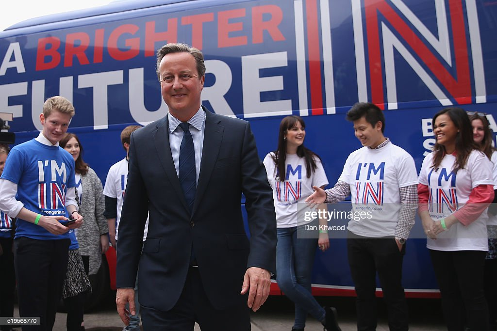 British Prime Minister <a gi-track='captionPersonalityLinkClicked' href=/galleries/search?phrase=David+Cameron+-+Politician&family=editorial&specificpeople=227076 ng-click='$event.stopPropagation()'>David Cameron</a> joins students at the launch of the 'Brighter Future In' campaign bus at Exeter University on April 7, 2016 in Exeter, England. The Government have announced that every household in the country will receive a taxpayer-funded leaflet on the referendum setting out the case for Britain to remain in the European Union. The UK will vote on whether or not to remain in the European Union on June 23, 2016.