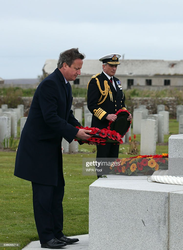 British Premier <a gi-track='captionPersonalityLinkClicked' href=/galleries/search?phrase=David+Cameron+-+Politician&family=editorial&specificpeople=227076 ng-click='$event.stopPropagation()'>David Cameron</a> lays a wreath as Admiral Sir Philip Jones looks on at the Lyness cemetery during the 100th anniversary commemorations for the Battle of Jutland on May 31, 2016 in Hoy, Scotland. The event marks the centenary of the largest naval battle of World War One where more than 6,000 Britons and 2,500 Germans died in the Battle of Jutland fought near the coast of Denmark on 31 May and 1 June 1916.