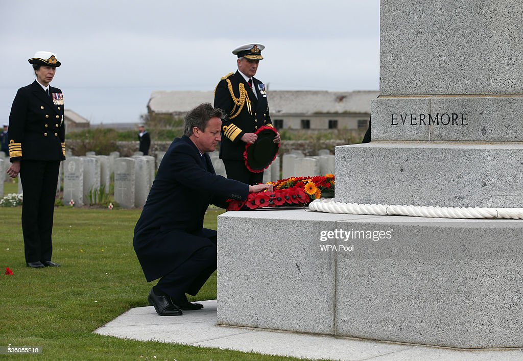 British Premier <a gi-track='captionPersonalityLinkClicked' href=/galleries/search?phrase=David+Cameron+-+Politician&family=editorial&specificpeople=227076 ng-click='$event.stopPropagation()'>David Cameron</a> lays a wreath as <a gi-track='captionPersonalityLinkClicked' href=/galleries/search?phrase=Princess+Anne+-+Princess+Royal&family=editorial&specificpeople=11706204 ng-click='$event.stopPropagation()'>Princess Anne</a>, Princess Royal and Admiral Sir Philip Jones look on at the Lyness cemetery during the 100th anniversary commemorations for the Battle of Jutland on May 31, 2016 in Hoy, Scotland. The event marks the centenary of the largest naval battle of World War One where more than 6,000 Britons and 2,500 Germans died in the Battle of Jutland fought near the coast of Denmark on 31 May and 1 June 1916.