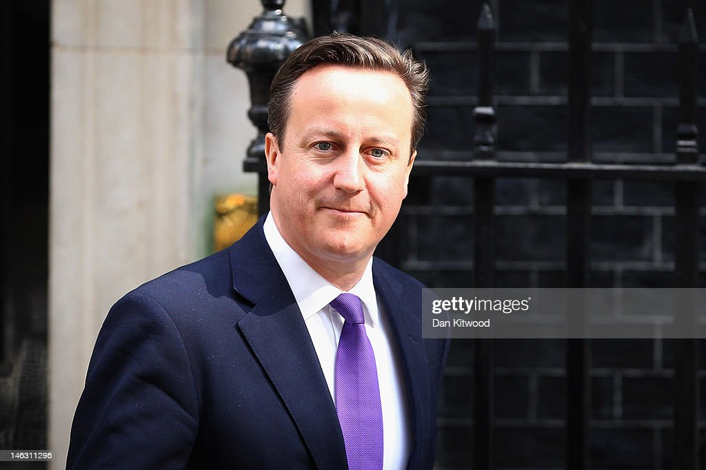 British Prime Minister David Cameron leaves 10 Downing Street ahead of his appearance at the Leveson Inquiry on June 14 2012 in London England This...