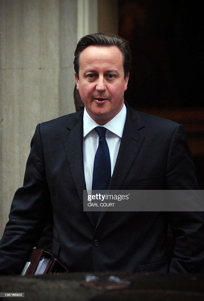 British Prime Minister David Cameron (C) leaves 10 Downing Street as he heads to the House of Commons in central London on November 21, 2012 for prime minister's question time.