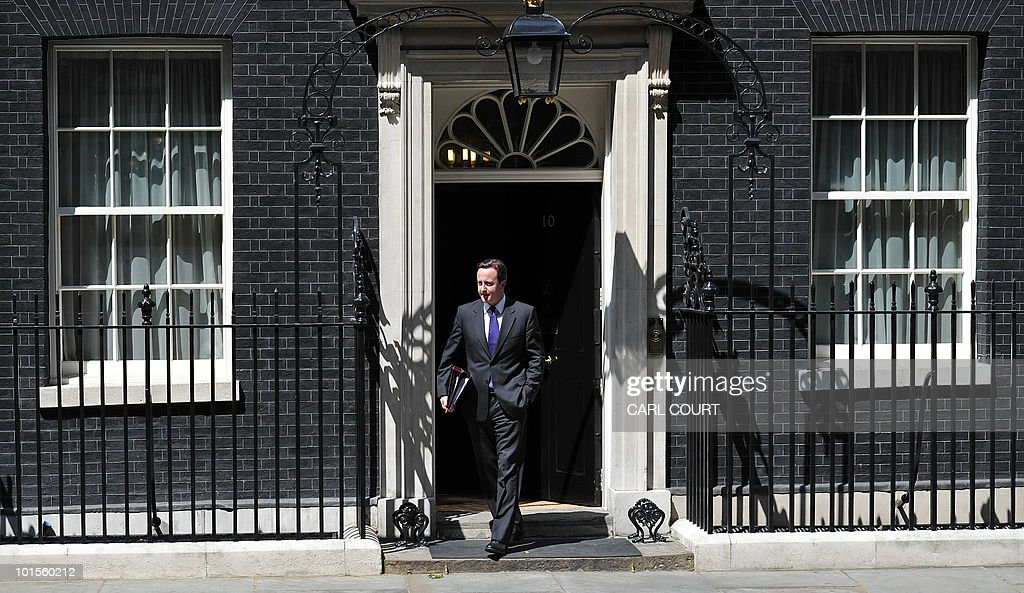 British Prime Minister David Cameron leaves 10 Downing Street in London, on June 2, 2010, as he heads for the House of Commons to address his first Prime Ministers Questions debate as Prime Minister. Cameron said he was 'alarmed and shocked' by the shootings of at least five people at the start of his first weekly grilling in the House of Commons after winning elections last month. 'At least five people have died,' he said, adding: 'The government will do everything it possibly can to help the local community and those affected.' AFP PHOTO/Carl Court
