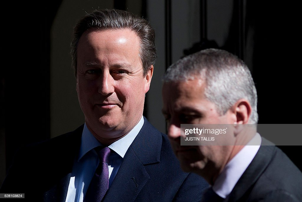 British Prime Minister David Cameron (L) leaves 10 Downing Street in central London on May 4, 2016. Londoners will chose their new mayor on May 5, while Scotland, Wales and Northern Ireland will also elect new national assemblies, with elections also taking place in 124 English local authorities. The round of elections is closely followed by the EU membership referendum on June 23, a major test of authority for Conservative Prime Minister David Cameron, who wants Britain to stay in the European Union. / AFP / JUSTIN