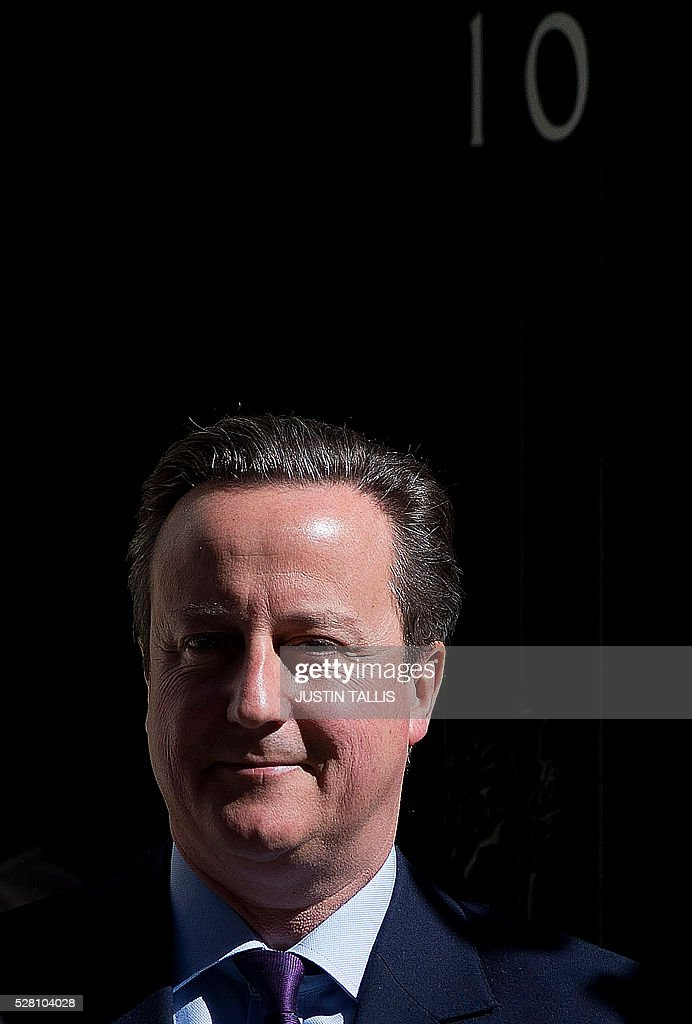British Prime Minister David Cameron leaves 10 Downing Street in central London on May 4, 2016. Londoners will chose their new mayor on May 5, while Scotland, Wales and Northern Ireland will also elect new national assemblies, with elections also taking place in 124 English local authorities. The round of elections is closely followed by the EU membership referendum on June 23, a major test of authority for Conservative Prime Minister David Cameron, who wants Britain to stay in the European Union. / AFP / JUSTIN