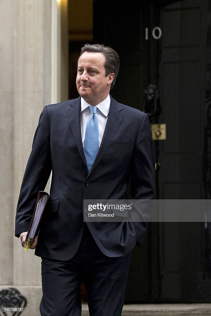 British Prime Minister <a gi-track='captionPersonalityLinkClicked' href=/galleries/search?phrase=David+Cameron+-+Politician&family=editorial&specificpeople=227076 ng-click='$event.stopPropagation()'>David Cameron</a> leaves 10 Downing Street on February 27, 2013 in London, England. Mr Cameron will deliver his weekly Prime Minister Questions at the Houses of Parliament later today.