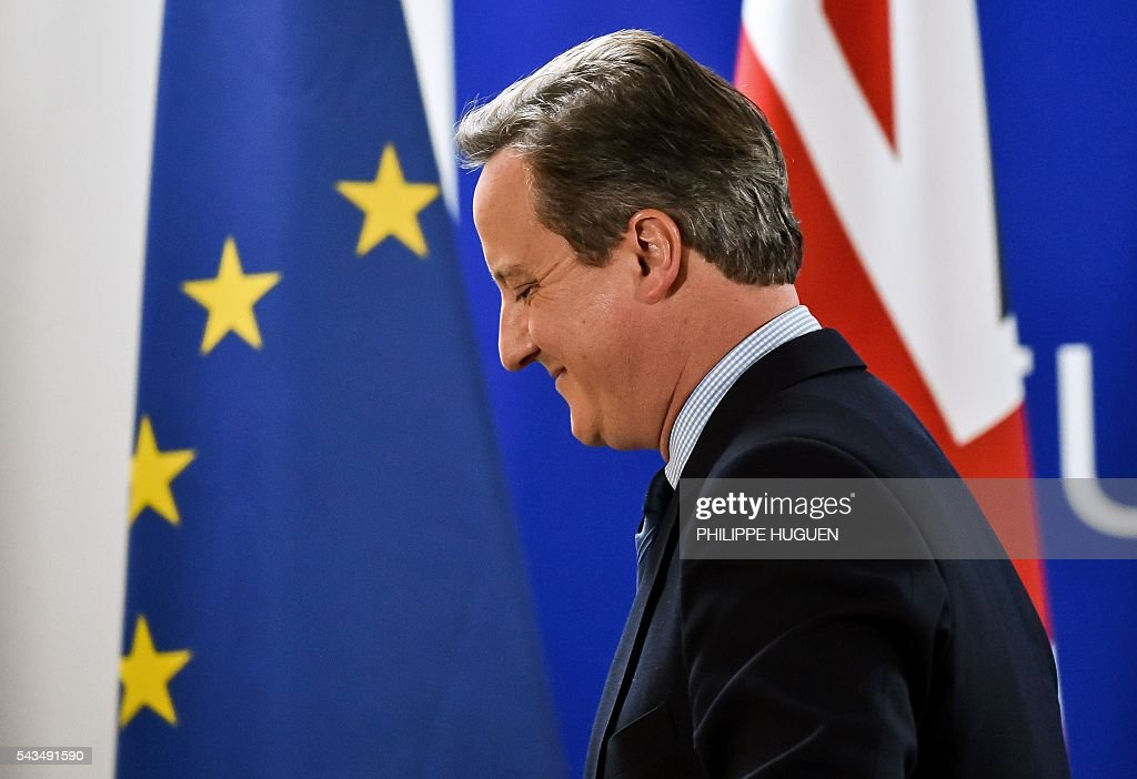British Prime minister David Cameron leaves a press conference during an European Union summit on June 28, 2016 at the EU headquarters in Brussels. Britain's exit from the European Union may erode the bloc's leadership role in fighting climate change and stymie crucial efforts to set more ambitious targets for cutting greenhouse gases, officials and experts said on June 28. European leaders meeting in Brussels pressured British Prime Minister David Cameron Tuesday to launch the two-year withdrawal process 'as soon as possible', but the embattled premier has vowed he will leave that task to a successor to be named on September 9. / AFP / PHILIPPE