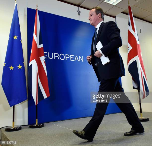 British Prime Minister David Cameron leaves after delivering a press conference on February 19 at a European Union summit in Brussels after reaching...