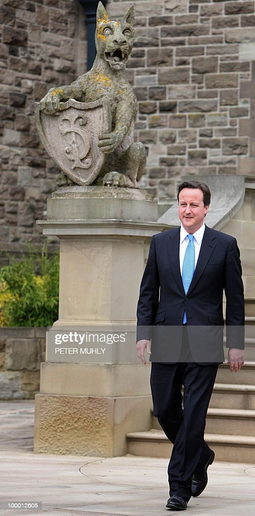 British Prime Minister David Cameron leaves, after meeting with Northern Ireland's First and Deputy First Ministers at Stormont Castle in Belfast, Northern Ireland May 20, 2010 . Cameron and his coalition deputy unveiled full details Thursday of their 'historic' power-sharing deal, under growing scrutiny for signs of strain. AFP PHOTO/Peter Muhly