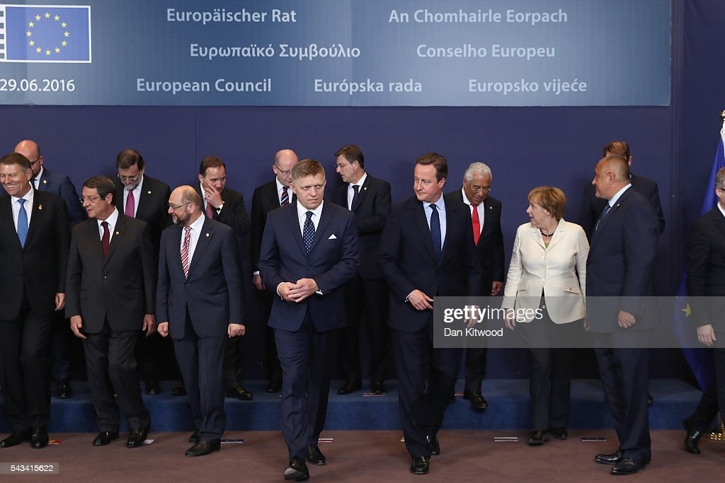 British Prime Minister <a gi-track='captionPersonalityLinkClicked' href=/galleries/search?phrase=David+Cameron+-+Politician&family=editorial&specificpeople=227076 ng-click='$event.stopPropagation()'>David Cameron</a> (centre right) leaves after the group family photo with the European Council during a European Council Meeting at the Council of the European Union on June 28, 2016 in Brussels, Belgium. British Prime Minister <a gi-track='captionPersonalityLinkClicked' href=/galleries/search?phrase=David+Cameron+-+Politician&family=editorial&specificpeople=227076 ng-click='$event.stopPropagation()'>David Cameron</a> will hold talks with other EU leaders in what will likely be his final scheduled meeting with the full European Council before he stands down as Prime Minister. The meetings come at a time of economic and political uncertainty following the referendum result last week which saw the UK vote to leave the European Union.