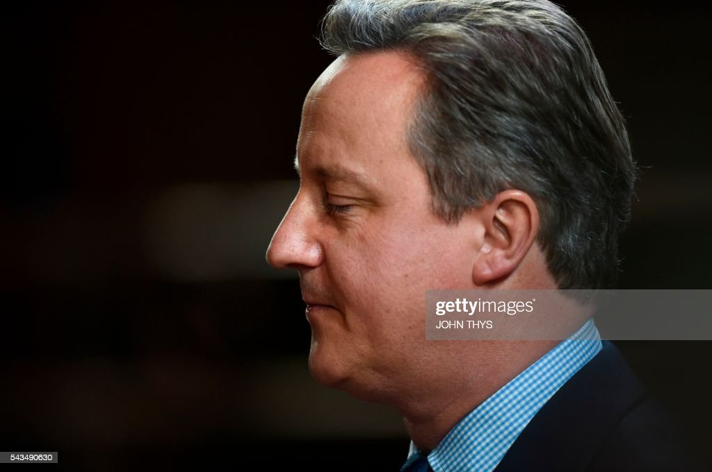 British Prime minister David Cameron leaves an European Union summit on June 28, 2016 at the EU headquarters in Brussels. Britain's exit from the European Union may erode the bloc's leadership role in fighting climate change and stymie crucial efforts to set more ambitious targets for cutting greenhouse gases, officials and experts said on June 28. European leaders meeting in Brussels pressured British Prime Minister David Cameron Tuesday to launch the two-year withdrawal process 'as soon as possible', but the embattled premier has vowed he will leave that task to a successor to be named on September 9. / AFP / JOHN
