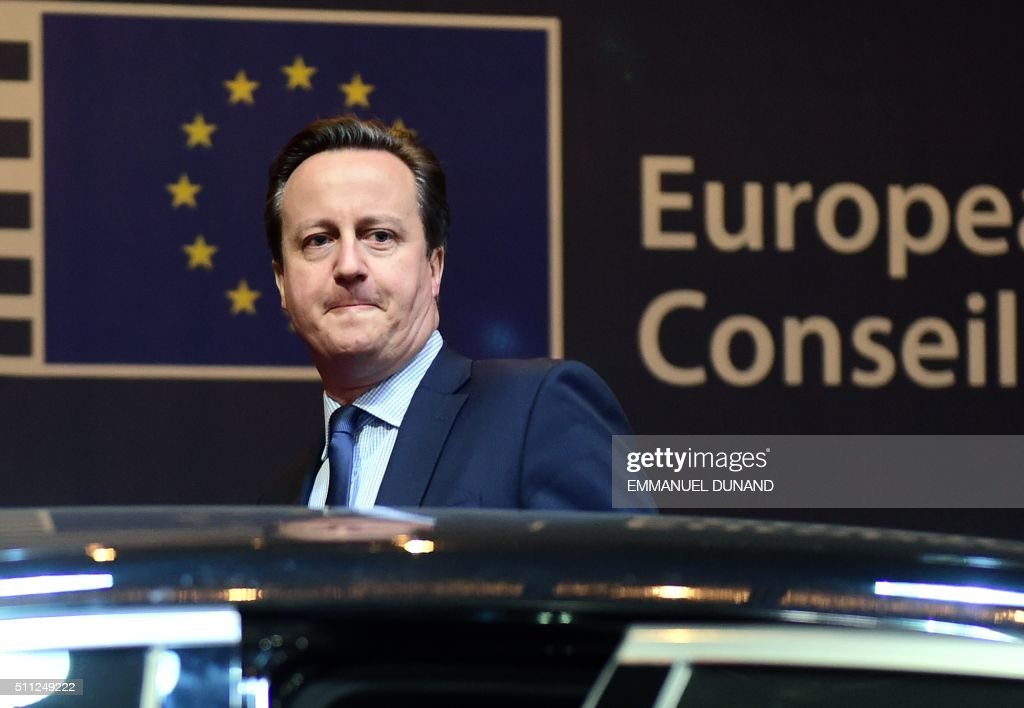 British Prime Minister David Cameron leaves at the end of the first day of an European Council leaders' meeting in Brussels, February 19, 2016. EU leaders head into a make-or-break summit sharply divided over difficult compromises needed to avoid Britain becoming the first country to crash out of the bloc. / AFP / Emmanuel DUNAND