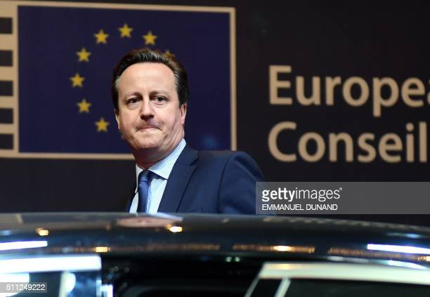 British Prime Minister David Cameron leaves at the end of the first day of an European Council leaders' meeting in Brussels February 19 2016 EU...