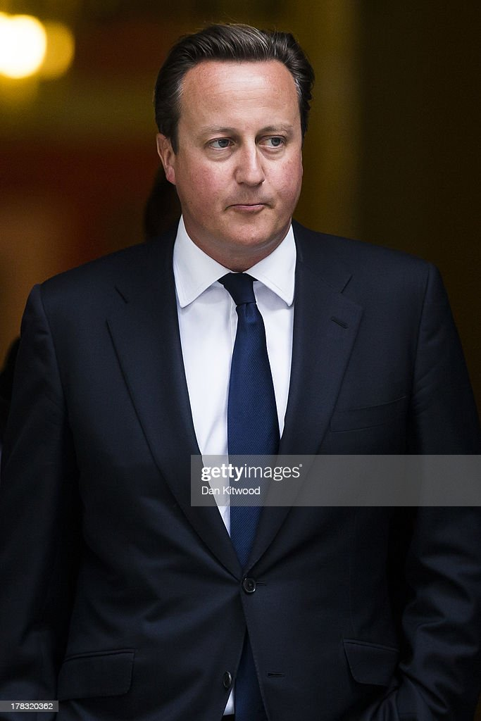 British Prime Minister <a gi-track='captionPersonalityLinkClicked' href=/galleries/search?phrase=David+Cameron+-+Politician&family=editorial&specificpeople=227076 ng-click='$event.stopPropagation()'>David Cameron</a> Leaves Downing Street on August 29, 2013 in London, England. Prime Minister <a gi-track='captionPersonalityLinkClicked' href=/galleries/search?phrase=David+Cameron+-+Politician&family=editorial&specificpeople=227076 ng-click='$event.stopPropagation()'>David Cameron</a> has recalled Parliament to debate the UK's response to a suspected chemical weapon attack in Syria.