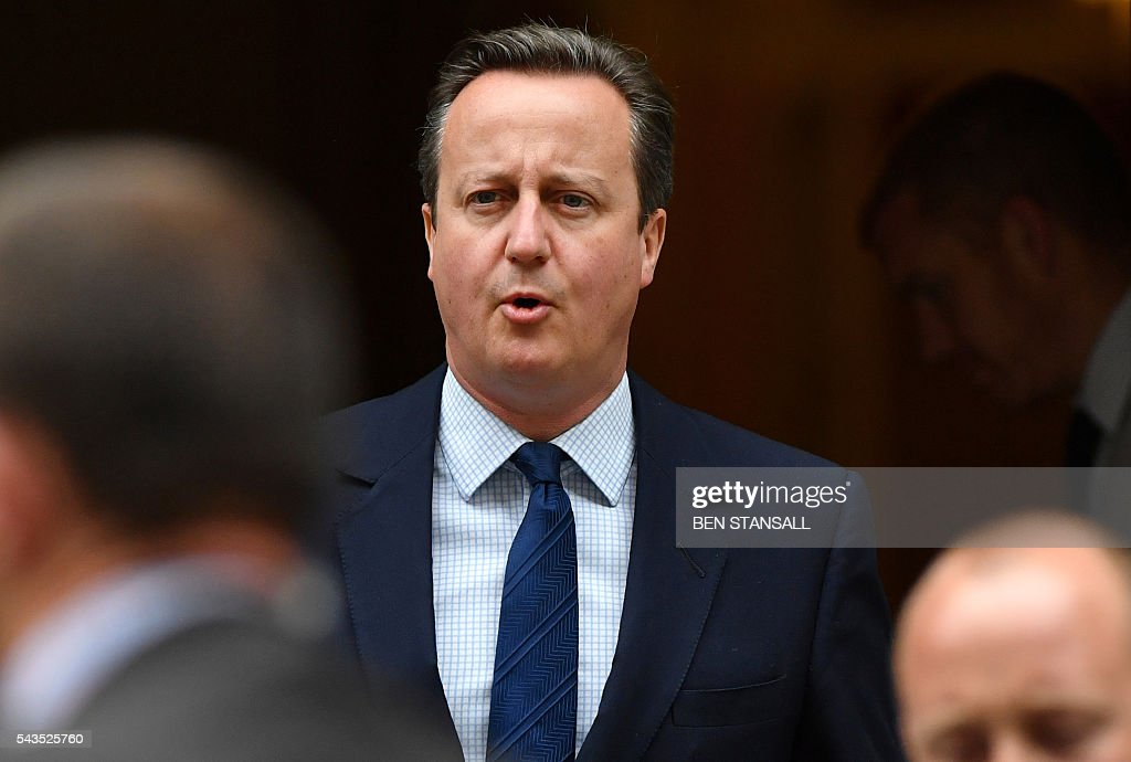 British Prime Minister David Cameron (C) leaves from 10 Downing Street in central London on June 29, 2016. European Union leaders will Wednesday assess the damage from Britain's decision to leave the bloc and try to prevent further disintegration, as they meet for the first time without a British representative. Cameron flew back to London after Tuesday's summit, as Sturgeon headed in the opposite direction to test the waters in Brussels for her country joining the bloc as a separate entity. / AFP / BEN