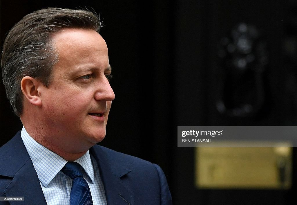 British Prime Minister David Cameron leaves from 10 Downing Street in central London on June 29, 2016. European Union leaders will Wednesday assess the damage from Britain's decision to leave the bloc and try to prevent further disintegration, as they meet for the first time without a British representative. Cameron flew back to London after Tuesday's summit, as Sturgeon headed in the opposite direction to test the waters in Brussels for her country joining the bloc as a separate entity. / AFP / BEN