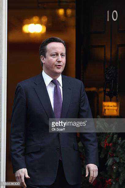 British Prime Minister David Cameron leaves Number 10 Downing Street to greet Hamad AlKhalifa the King of Bahrain on December 12 2011 in London...