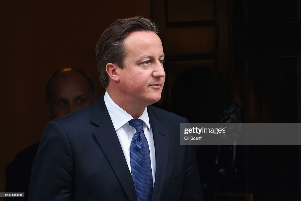 British Prime Minister <a gi-track='captionPersonalityLinkClicked' href=/galleries/search?phrase=David+Cameron+-+Politician&family=editorial&specificpeople=227076 ng-click='$event.stopPropagation()'>David Cameron</a> leaves Number 10 Downing Street after attending the weekly Cabinet meeting on October 16, 2012 in London, England. Home Secretary Theresa May will decide today on whether to extradite computer hacker Gary McKinnon, who suffers from Asperger's Syndrome, to the United States for illegally accessing dozens of military computers.