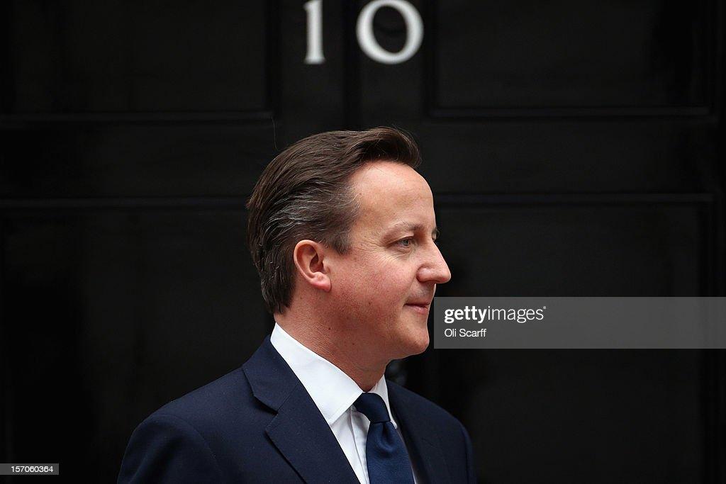 British Prime Minister David Cameron leaves Number 10 Downing Street to greet His Highness the Amir Sheikh Sabah AlAhmad AlJaber AlSabah of Kuwait on...