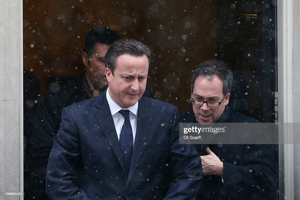 British Prime Minister David Cameron (L) leaves Number 10 Downing Street in the snow as he travels to the House of Commons to deliver a statement on the unfolding hostage situation in Algeria on January 18, 2013 in London, England. Islamist militants had claimed to be holding 41 foreigners hostage at a gas treatment plant in the Algerian desert. At least four hostages and several militants were killed yesterday when Algerian troops stormed an area of the plant.